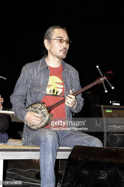 Japanese musician Takashi Hirayasu performs live on stage during the 'World Got the Blues' concert at St Lukes in London on 1st June 2004.