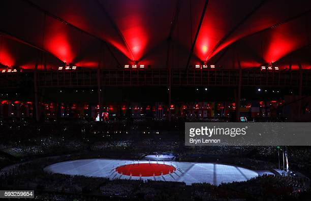Japanese national anthem is performed at the 'Love Sport Tokyo 2020' segment during the Closing Ceremony on Day 16 of the Rio 2016 Olympic Games at...