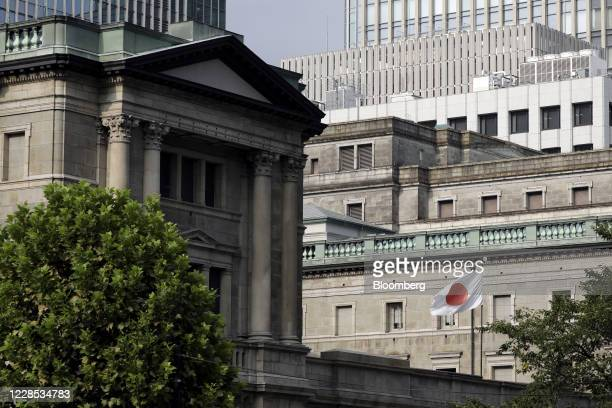 Japanese national flag flies outside the Bank of Japan headquarters in Tokyo, Japan, on Monday, Sept. 14, 2020. The Bank of Japan left its...