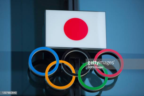 Japanese National Flag over the Olympic Rings symbol is seen at the entrance of the Japan Olympic Museum in Shinjuku Japanese start thinking that it...