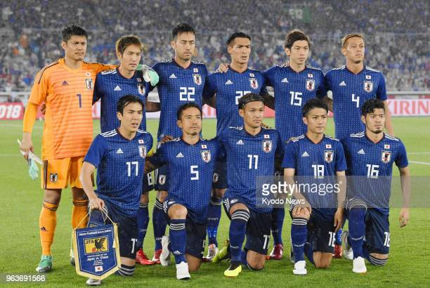 Japanese national football team members pose for photos ahead of a friendly match against Ghana at Nissan Stadium in Yokohama near Tokyo on May 30...