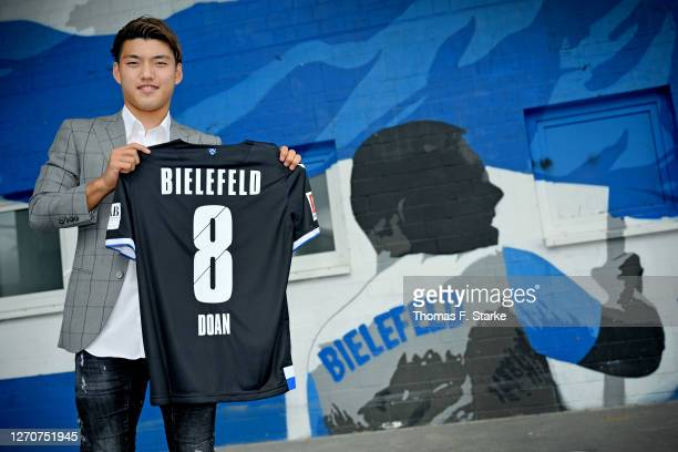 Japanese national player Ritsu Doan poses for a photo after signing a loan contract with Bundesliga club Arminia Bielefeld at Schueco-Arena on...
