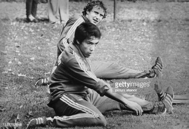 Japanese national striker Jasuhiko Okudera during his first practice in Cologne on 10th October 1977 Behind him Heinz Flohe 1 FC Köln was the first...
