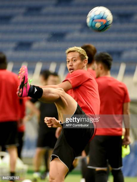 Japanese national team forward Keisuke Honda kicks a ball during the training session at Saitama Stadium in Saitama on August 30, 2017. Japan will...