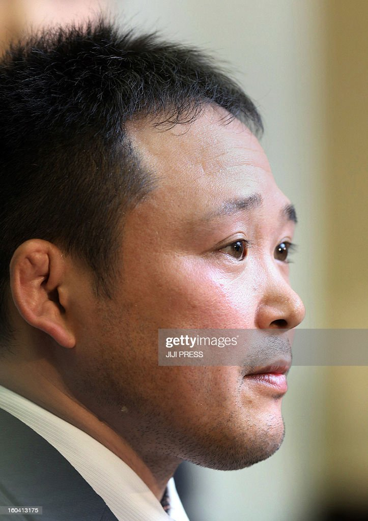 Japanese national women's judo head coach Ryuji Sonoda announces his resignation in Tokyo on January 31, 2013 after allegations emerged he had beaten his athletes with wooden swords. A group of female judokas, including some who took part in the London Olympics, had complained to the Japanese Olympic Committee that they had been physically abused. JAPAN
