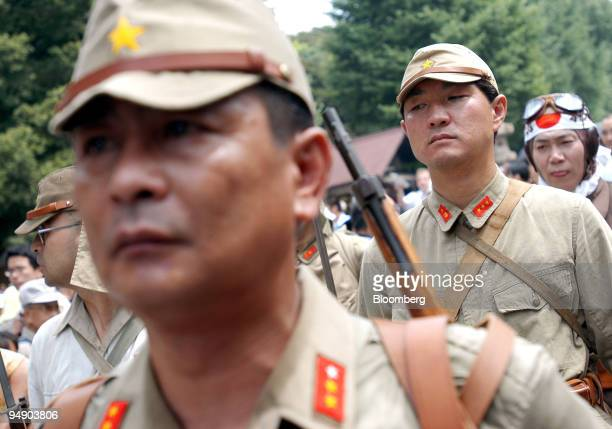 Japanese nationalists dressed in World War II military uniforms march into Yasukuni Shrine in Tokyo Monday August 15 2005 Japan today marks 60 years...