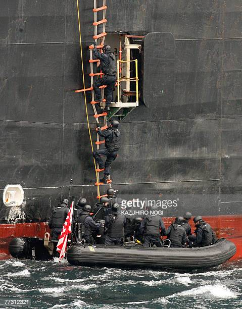 Japanese naval personnel use a speedboat climb a rope ladder to catch up with a target ship the US transport ship 1st Lt Harry Martin during...