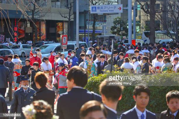 japanese new adults wearing kimonos and suits on 'coming of age day' on the street in yokohama - seijin no hi stock pictures, royalty-free photos & images