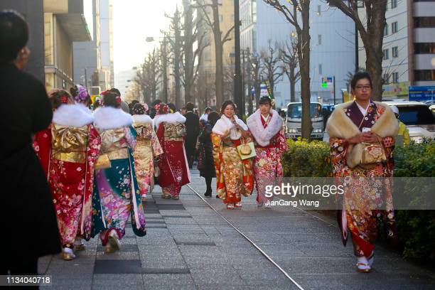 japanese new adults wearing kimonos on 'coming of age day' on the street in yokohama - seijin no hi stock pictures, royalty-free photos & images