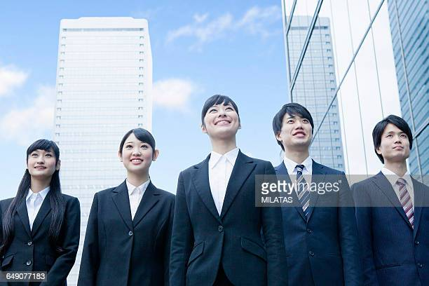 japanese new society who stand in the office - ルーキー ストックフォトと画像