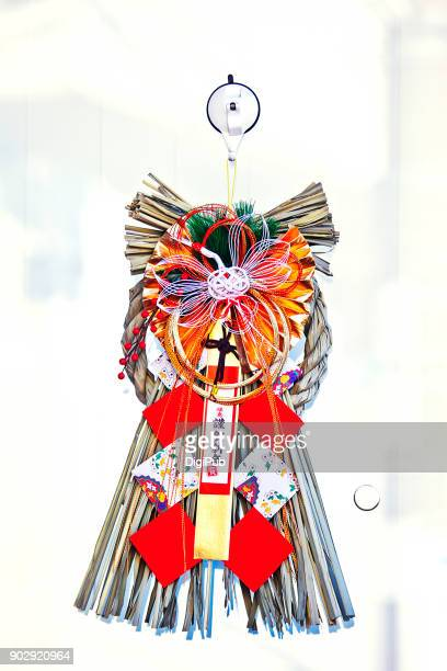 Japanese New Year Decoration hanging on glass door