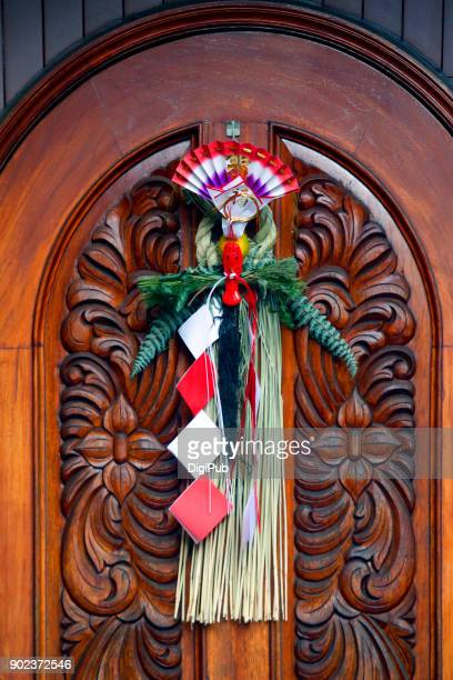 Japanese New Year Decoration hanging on the wood door