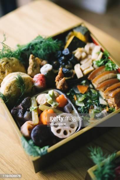 japanese new year's day food osechi ryori - osechi ryori stock pictures, royalty-free photos & images