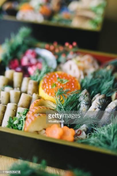 japanese new year's eve food osechi ryori - osechi ryori stock pictures, royalty-free photos & images