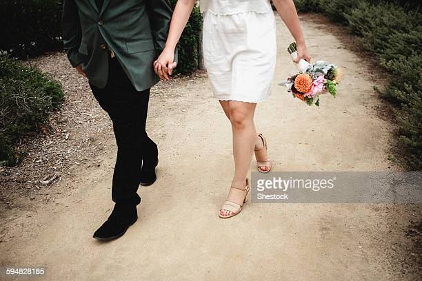 japanese newlywed couple walking outdoors - mens dress shoes stock pictures, royalty-free photos & images