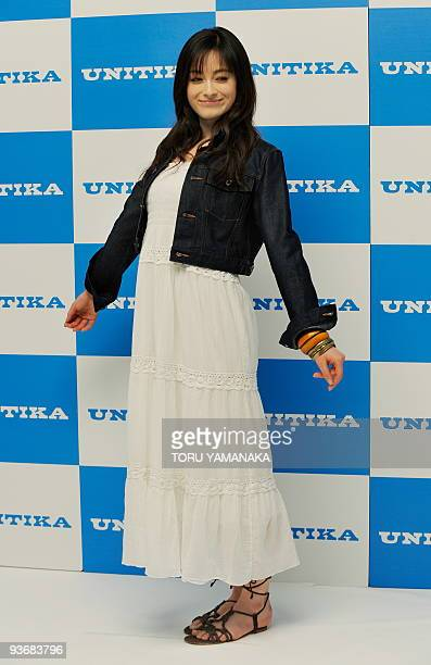 Japanese nineteenyearold model Erica poses for photographers at an event to introduce her as campaign girl 2010 of Japan's textile maker Unitika in...