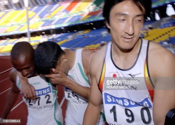 Japanese Nobuharu Asahara looks dejected as Saudi Arabian Jamal Al Saffar shows his emotions to his compatriot Salem Al Yami after the latter won the...