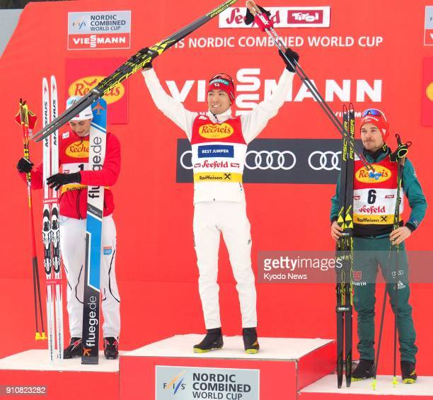 Japanese Nordic combined competitor Akito Watabe poses on the podium after winning a World Cup event in Seefeld Austria on Jan 26 alongside...