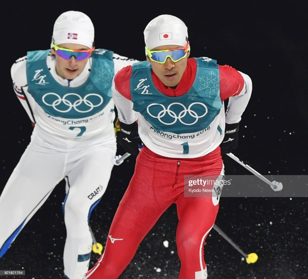 Japanese Nordic combined skier Akito Watabe (1) competes with Jarl Magnus Riiber (2) of Norway in the cross-country portion of the individual large hill 10-kilometer race at the Pyeongchang Winter Olympics in South Korea on Feb. 20, 2018. ==Kyodo
