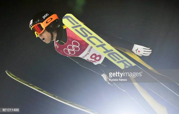 Japanese Nordic combined skier Akito Watabe soars through the air in the ski jumping leg of the individual large hill 10-kilometer race at the...