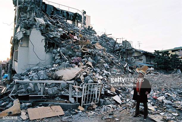 JANUARY 17 Japanese novelist Akiyuki Nosaka who was born in Kobe inspects destroyed buildings after the massive earthquake in that killed more than...