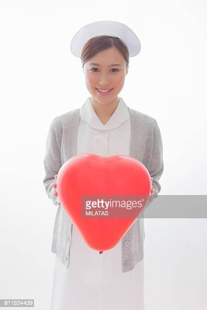 Japanese nurse with balloons