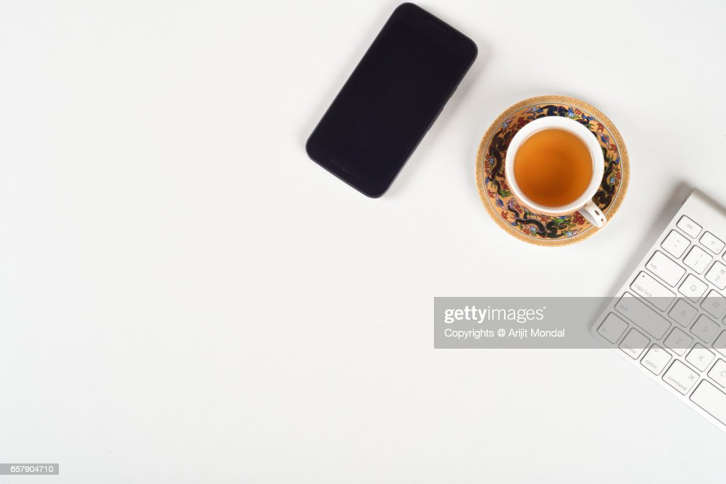 top office table cup. Japanese Office Desk Top View With Mobile Phone, Tea Cup Plate, Pot, Table