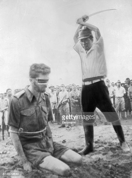 A Japanese officer with raised sword prepares to execute an Australian Aircorps prisoner of war in Japanese held territory during World War II