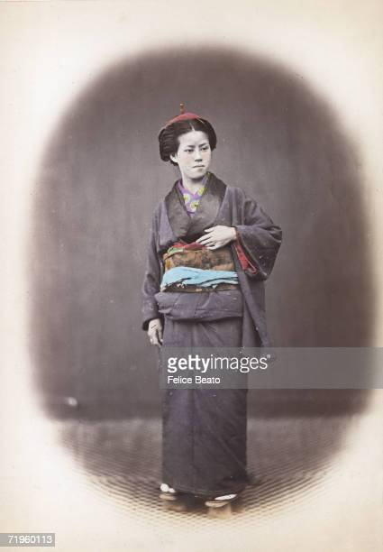 A Japanese officer's wife in kimono and obi circa 1865