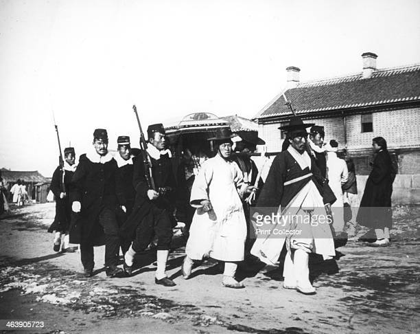Japanese official with an escort of soldiers Korea c1900