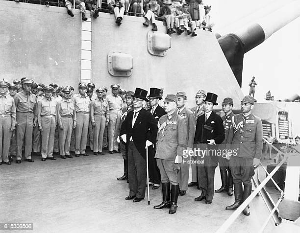 Japanese officials arrive aboard the USS Missouri in Toyko Bay to sign the Japanese unconditional surrender document on September 2 1945