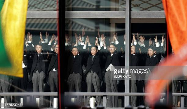 TOPSHOT Japanese officials shout banzai cheers for Emperor Naruhito and Empress Masako during the enthronement ceremony where emperor officially...