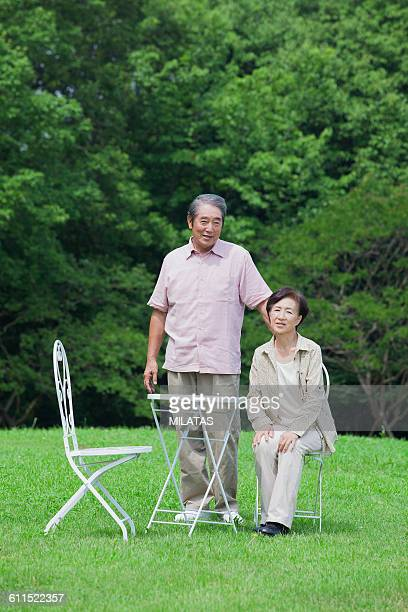 Japanese old man relaxing in a lawn
