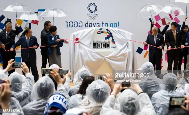 Japanese Olympic Committee President Tsunekazu Takeda Tokyo 2020 Chief Executive Officer Toshiro Muto 2nd L0 Tokyo Governor Yuriko Koike and Shunichi...