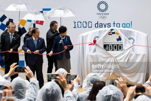 Japanese Olympic Committee President Tsunekazu Takeda Tokyo 2020 Chief Executive Officer Toshiro Muto and Tokyo Governor Yuriko Koike unveil a...