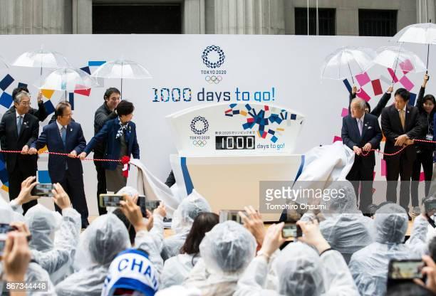 Japanese Olympic Committee President Tsunekazu Takeda Tokyo 2020 Chief Executive Officer Toshiro Muto Tokyo Governor Yuriko Koike and Shunichi Suzuki...