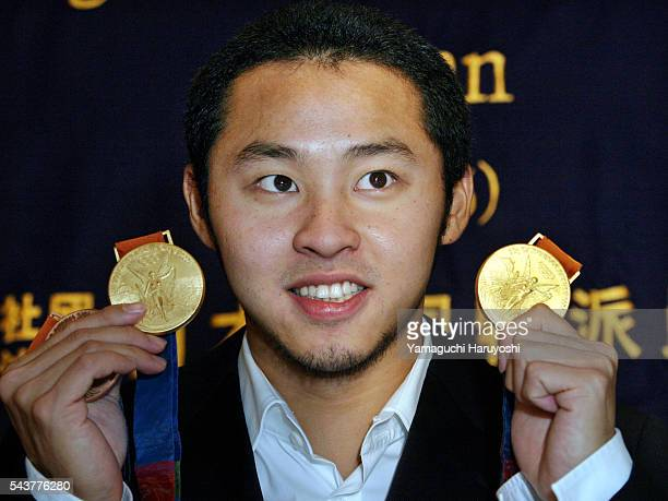 Japanese Olympic swimmer Kosuke Kitajima shows off his two gold medals he won in men's 100meter and 200meter breaststroke competitions in Athens...