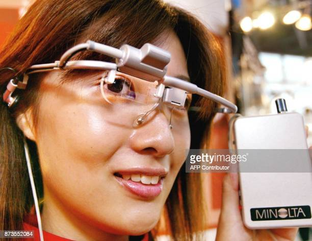 Japanese optical giant Minolta unveils a prototype of glasses shaped with a fullcolor holographic display called 'Holographic Seethrough Display' at...