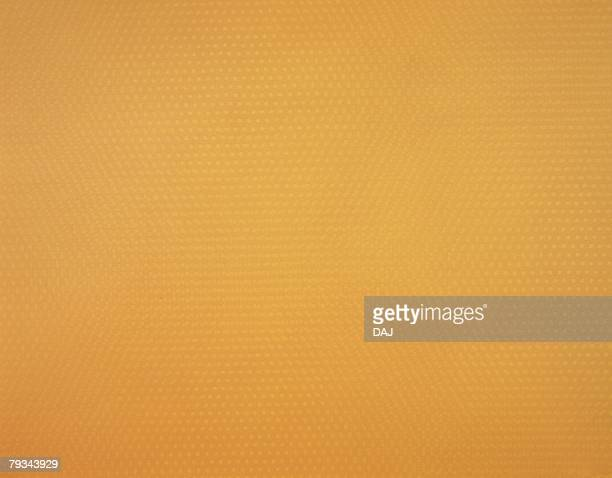 Japanese paper colored orange with spots, close up