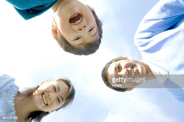 Japanese parents and boy smiling, direlctly below