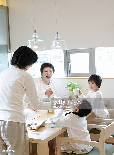 Japanese parents and children laughing