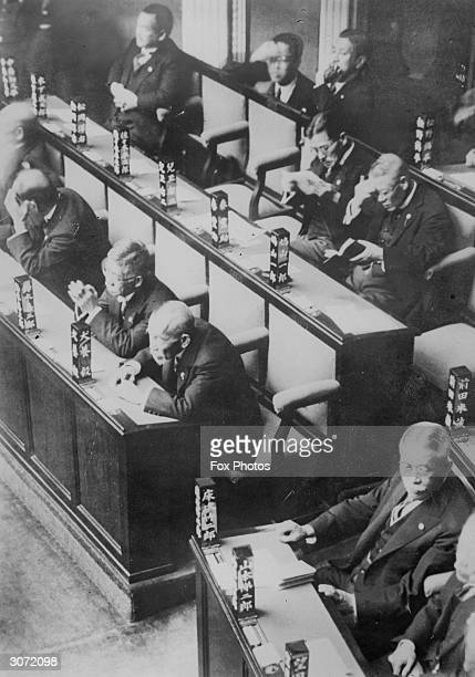 Japanese parliamentarians in the House of Representatives in Japan with their names inscribed on blocks of wood which remain on the desks in front of...