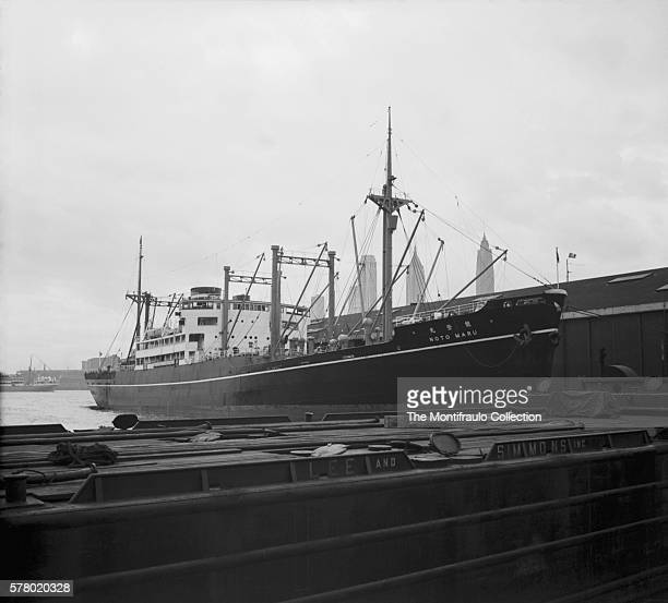 Japanese passanger cargo ship Noto Maru built in 1934 docked at New York harbour In the background can be seen the 72story Cities Service Building...