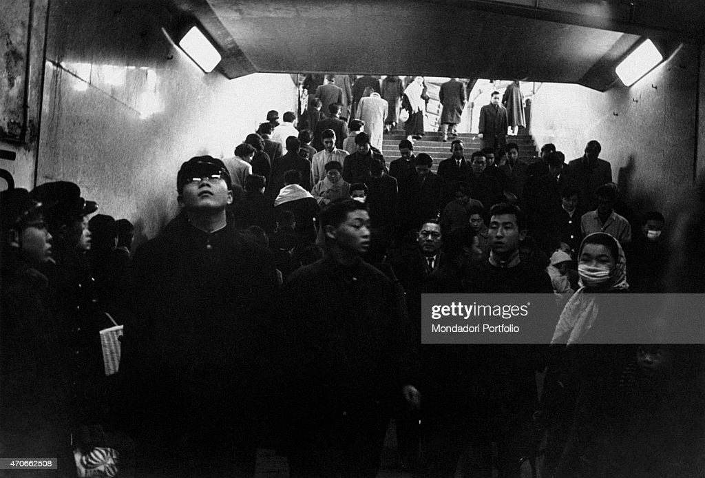a japanese pedestrian underpass crossroad of a large croud of