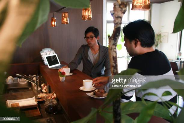 Japanese people relaxing in an atmosphereful cafe