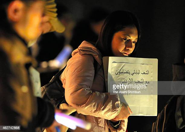 Japanese people show their condolences for slain Jordanian pilot Muath Al Kasasbeh, who was executed by the Islamic State militant group, outside the...