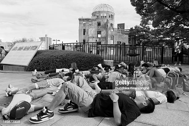 Japanese people stage a diein protest in front of the Hiroshima Peace Memorial commonly called the Atomic Bomb Dome at the Hiroshima Peace Memorial...