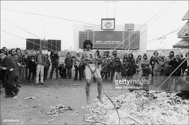 Japanese performance artist Minoru Yoshida performs 'Liftoff' during AvantGarde Festival at Shea Stadium in Queens New York New York November 11 1974