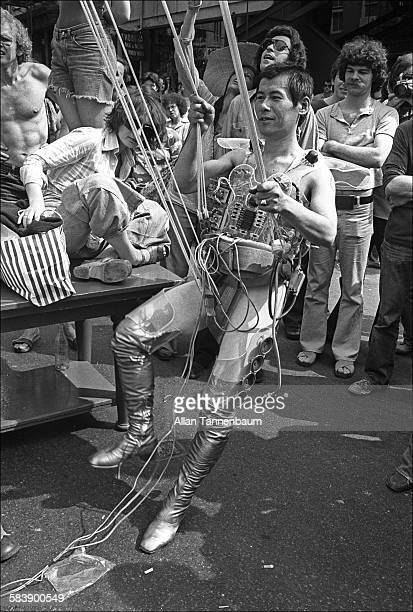 Japanese performance artist Minoru Yoshida prepares to launch himself via an elaborate system of ropes from West Broadway New York New York May 15...