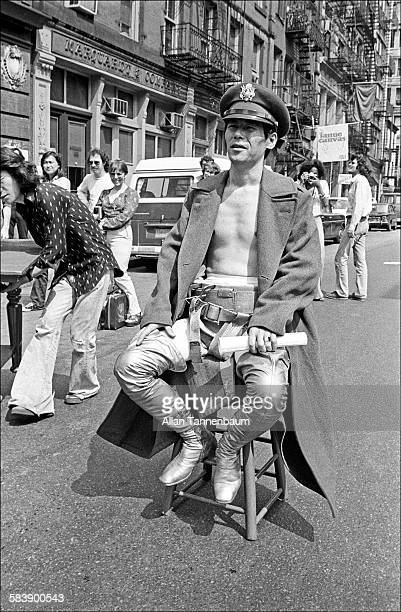 Japanese performance artist Minoru Yoshida sits on a stool in the middle of a SoHo street as he prepares for his 'Flight' performance New York New...